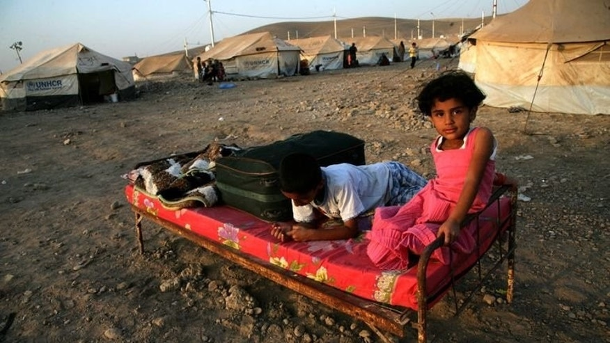 Syrian-Kurdish children sit on a bed at the Quru Gusik refugee camp, 20 kilometres east of the of Arbil, the capital of the autonomous Kurdish region of northern Iraq, on August 22, 2013. The number of children who have fled war-torn Syria hit one million Friday, while two million kids have been displaced within their homeland's borders by the conflict, the UN said.
