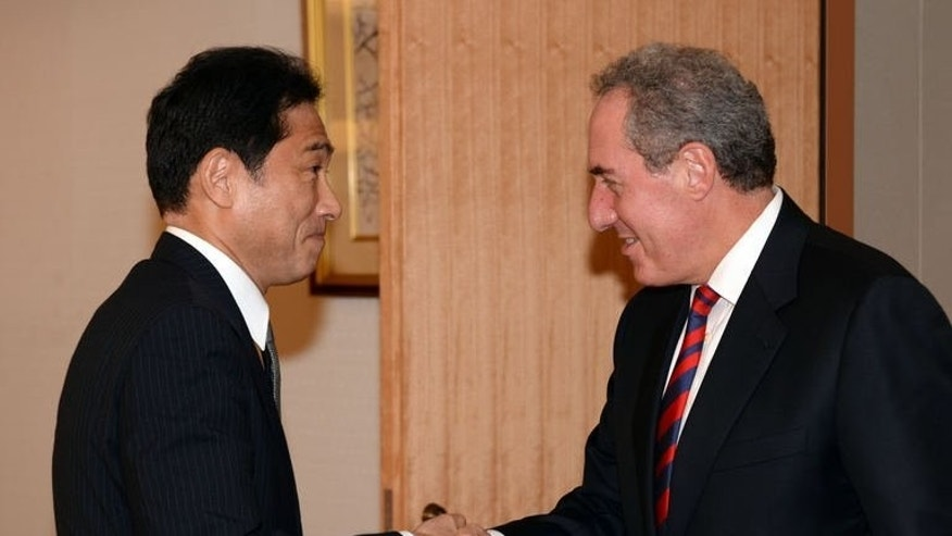 US Trade Representative Michael Froman (R) is greeted by Japanese Foreign Minister Fumio Kishida (L) at the foreign ministry in Tokyo on August 19, 2013. Representatives from countries negotiating a Pacific free trade pact that will cover nearly 40 percent of global economic output said Friday that differences between them persisted, as Froman sought to assuage concerns over a looming deadline.
