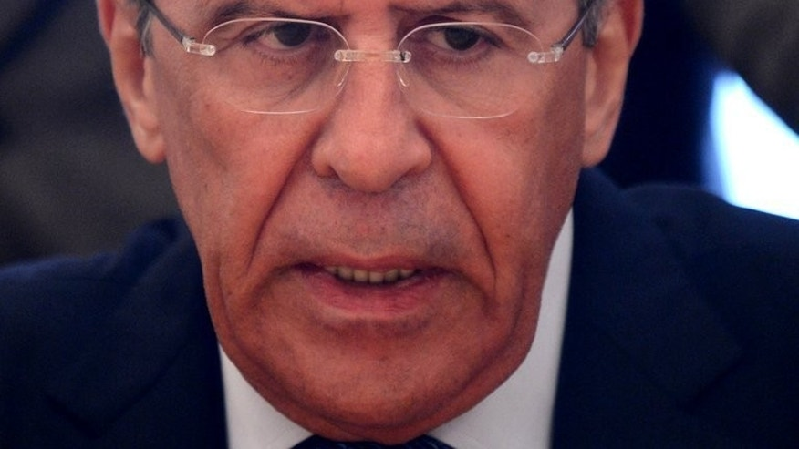 Russian Foreign Minister Sergei Lavrov speaks with Syrian deputy Prime Minister Qadri Jamil in Moscow on July 22, 2013. Russia said on Friday it had told Syria to cooperate with UN experts investigating reports of a deadly chemical weapons attack, and called on rebels to allow access to the area.