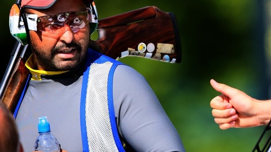Ronjan Sodhi receives a thumbs-up from a fellow competitor during the men's Double Trap qualification of the shooting event of the London Olympic Games, at the Royal Artillery Barracks, on August 2, 2012. Sodhi, a double-trap world record holder in 2010 and 2011, has been named winner of India's highest sports award.