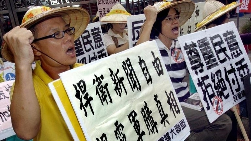 A rally in Taipei in 2005 against Taiwan buying arms from the United States. President Ma Ying-jeou said Friday the island will continue to acquire arms from the US, dismissing reports that the US and China could discuss ending such sales.