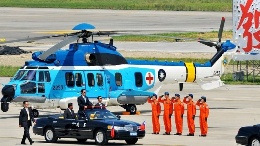 "Taiwan President Ma Ying-jeou (standing in car) reviews a Eurocopter EC-225 rescue helicopter in Taipei last year. ""To acquire necessary weapons that we can't manufacture ourselves, we will keep buying arms from the United States,"" Ma said during a visit to the offshore island of Kinmen to mark the 55th anniversary of a bombardment by the Chinese army that killed 618 servicemen and civilians."