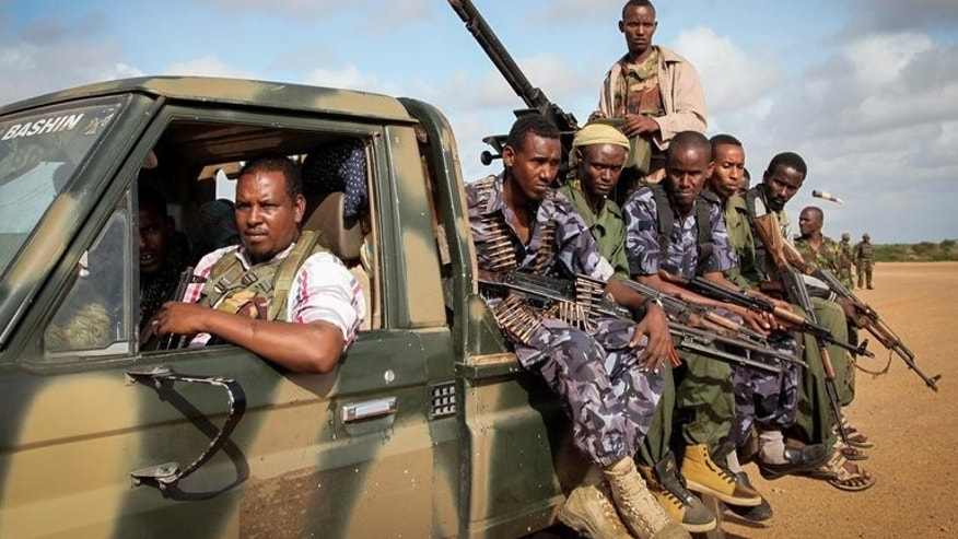 Fighters of the pro-government Ras Kimboni Brigade at Kismayo Airport in southern Somalia on August 22. Hopes that Somalia may soon turn the page on decades of anarchy have been dealt a string of blows, giving the internationally-backed government little to cheer as it marks its first birthday.