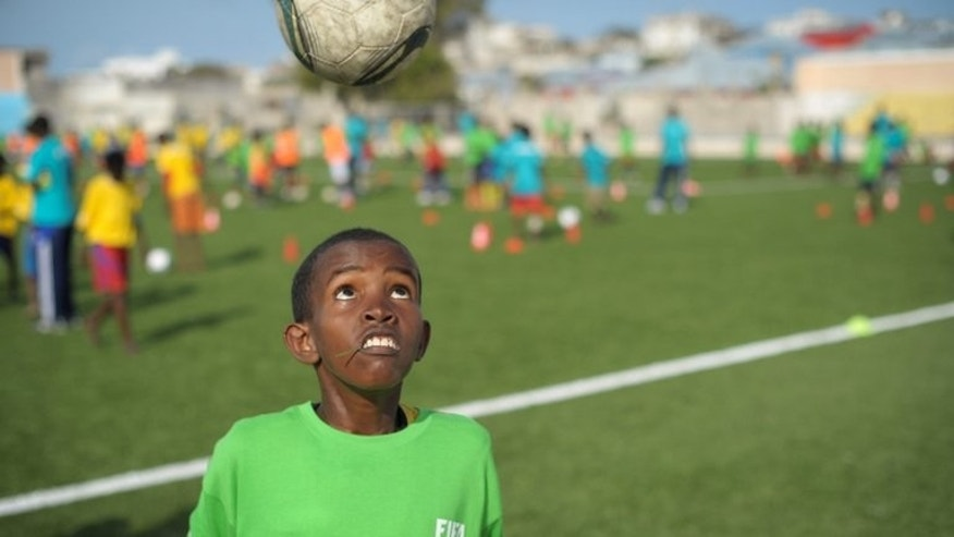 A boy heads a ball as children play football at a camp for Internally Displaced Persons in Mogadishu on August 19. Outside the city, the weak central government has little influence, with much of the country fractured into autonomous regions, including the self-declared and fiercely independent northern Somaliland.