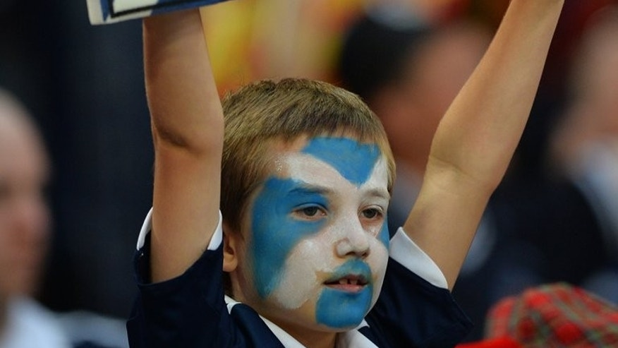 A young Scottish fan waits for kick off at Wembley Stadium in London on August 14, 2013. Watford's Ikechi Anya on Friday received his first Scotland call-up after being named in the squad for the World Cup qualifiers against Belgium and Macedonia next month.