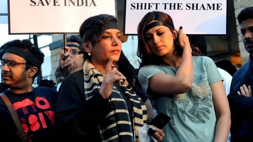 Indian Bollywood actresses Shabana Azmi and Sonali Bendre take part in a candlelit vigil in Mumbai on December 29, 2012, after the death of a gang-rape victim from New Delhi. A woman photographer gang-raped by five men in Mumbai is currently in hospital.
