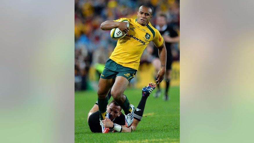 Australian's Will Genia avoids a tackle by New Zealand's Aaron Cruden to score a try during their opening Rugby Championship/Bledisloe Cup Test match in Sydney, on August 17, 2013. All Blacks won 47-29 and are hosting the Wallabies in Wellington for their next match, on Saturday.