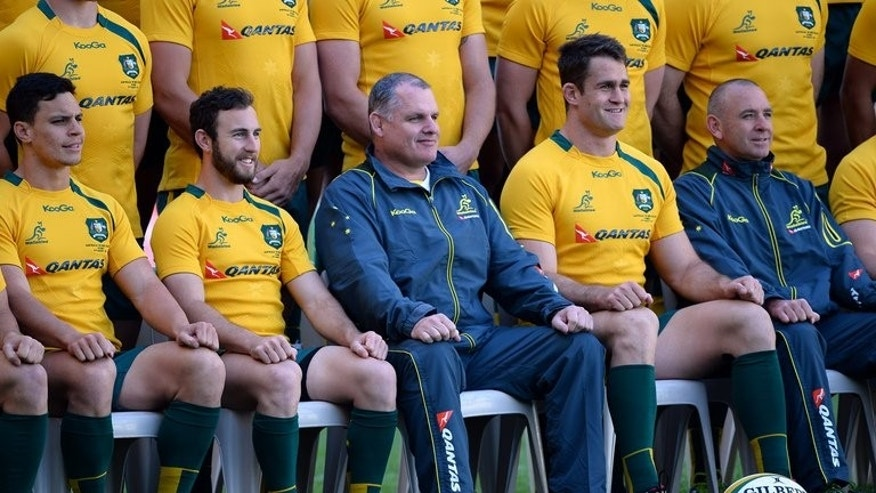 Australian Wallabies captain James Horwill (2nd R) along with coach Ewen McKenzie (C) of the Australian Wallabies pose for a photograph prior to the captain's run, in Sydney, on August 16, 2013.
