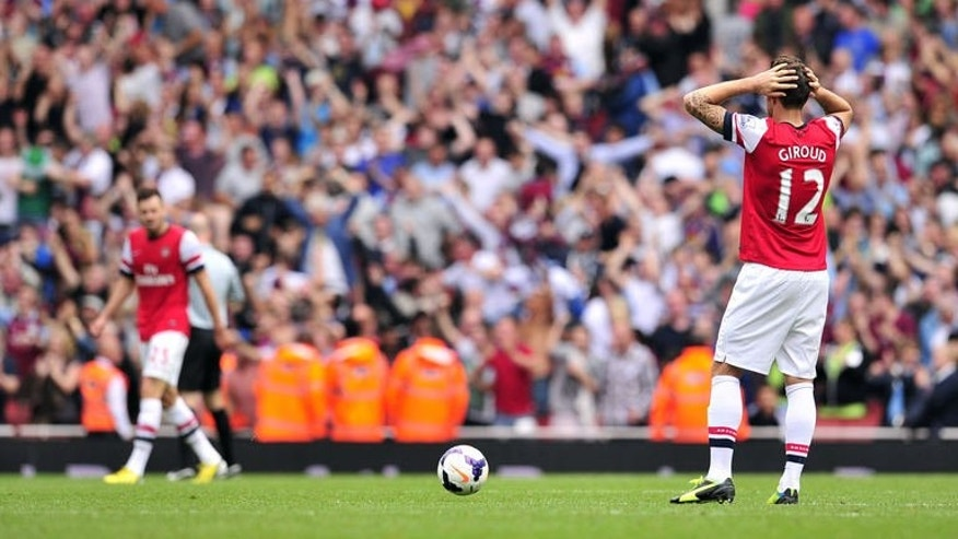 Arsenal striker Olivier Giroud (R) reacts during the match against Aston Villa in London on August 17, 2013. Arsenal will hope to carry the momentum from their mid-week Champions League victory over Fenerbahce into their trip to London rivals Fulham on Saturday.