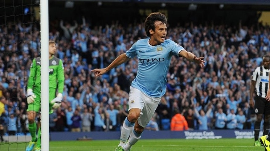 Manchester City midfielder David Silva celebrates after scoring a goal in match against Newcastle United in Manchester, on August 19, 2013. Manchester City face Cardiff City on Sunday.