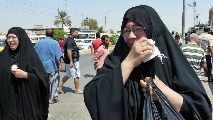 Iraqi women mourn victims of a suicide bombing in Baghdad's al-Qahira neighbourhood on August 24, 2013. Funerals were held for victims of the attack that killed 28 people in a city park, even as authorities pressed operations against militants to stem growing violence.