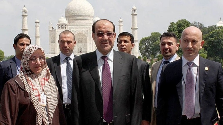 Iraqi Prime Minister Nuri Al-Malaki (C) is accompanied by members of his entourage on a visit to India's Taj Mahal on August 24, 2013.