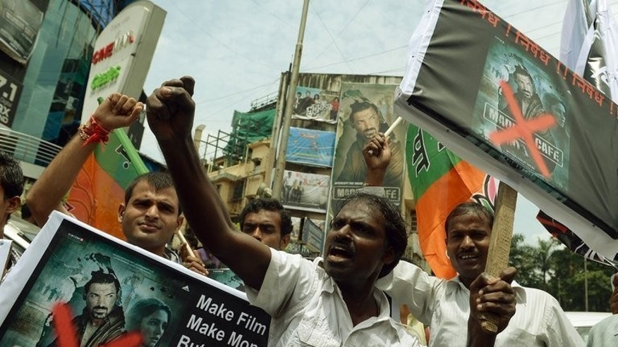 "Indian Tamils protest against the release of ""Madras Cafe"" in Mumbai on August 22, 2013. The Bollywood spy thriller set against the backdrop of the Sri Lankan civil war has been pulled from British and some Indian theatres after protests over its depiction of rebel fighters."