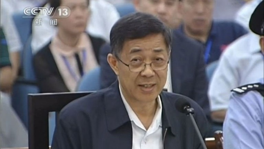 Fallen Chinese political star Bo Xilai (C) speaks during his trial at the Intermediate People's Court in Jinan, in this CCTV screen grab from August 24, 2013. Bo launched a scathing attack on a key witness in his corruption trial, saying even the most stupid official knows not to discuss bribery where they can be overheard.