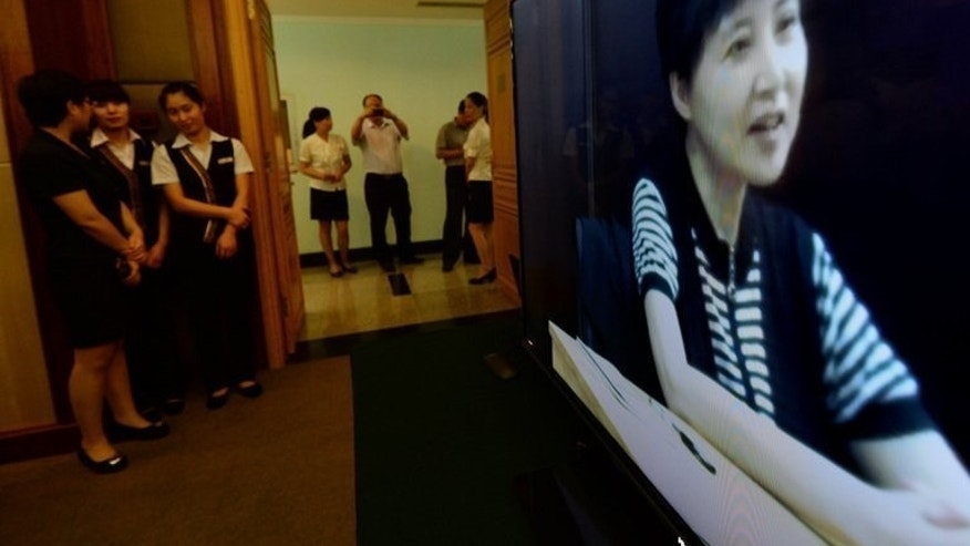 Gu Kailai, the wife of disgraced politician Bo Xilai, gives a recorded testimony during his trial at the Intermediate People's Court in Jinan, Shandong Province on August 23, 2013.