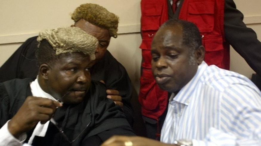 Lawyer Mike Ozekhome (L) chats with client Diepreye Alamieyesiegha on December 20, 2005, in Lagos. Gunmen have kidnapped the prominent lawyer and social critic in southern Nigeria in an apparent ransom bid, a colleague and police said Saturday.