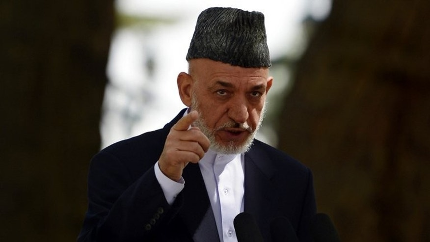 Hamid Karzai addresses a press conference at the presidential palace in Kabul on August 24, 2013. The Afghan President called for next year's crucial election to be a US-style head-to-head contest between two candidates, and named three possible runners in the wide-open race.