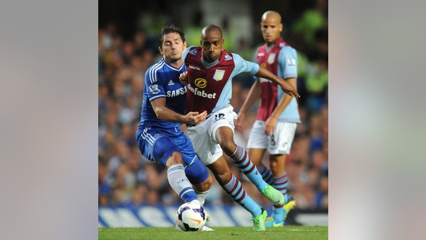 Chelsea's Frank Lampard (L) vies with Aston Villa's Fabian Delph during their English Premier League match at Stamford Bridge in London, on August 21, 2013. Aston Villa play Liverpool next, at home, on Saturday.