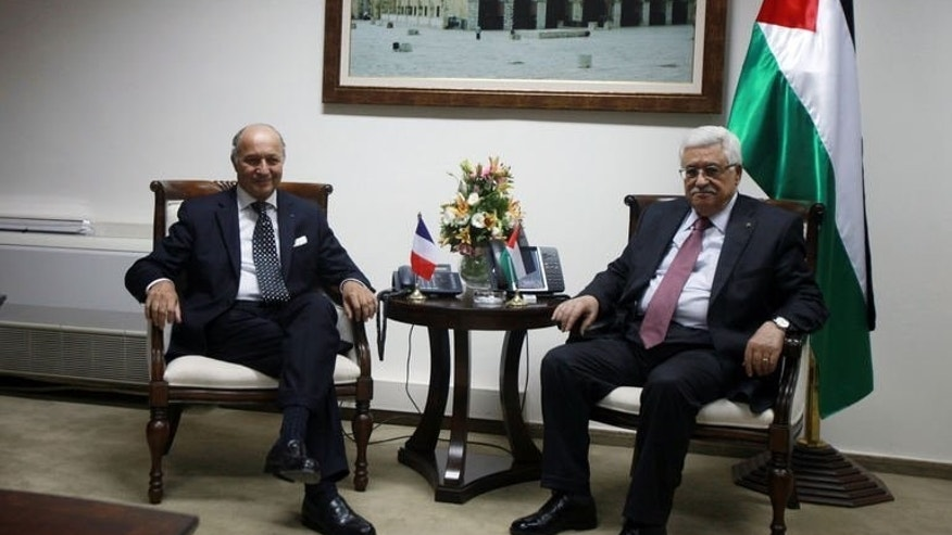 "French Foreign Minister Laurent Fabius meets with Palestinian President Mahmud Abbas (R) on August 24, 2013 in the West Bank city of Ramallah. A successful outcome to the US-brokered negotiations between Israel and the Palestinians would be like a ""thunderbolt"" for peace in the crisis-ridden Middle East, French Foreign Minister Laurent Fabius said Saturday."