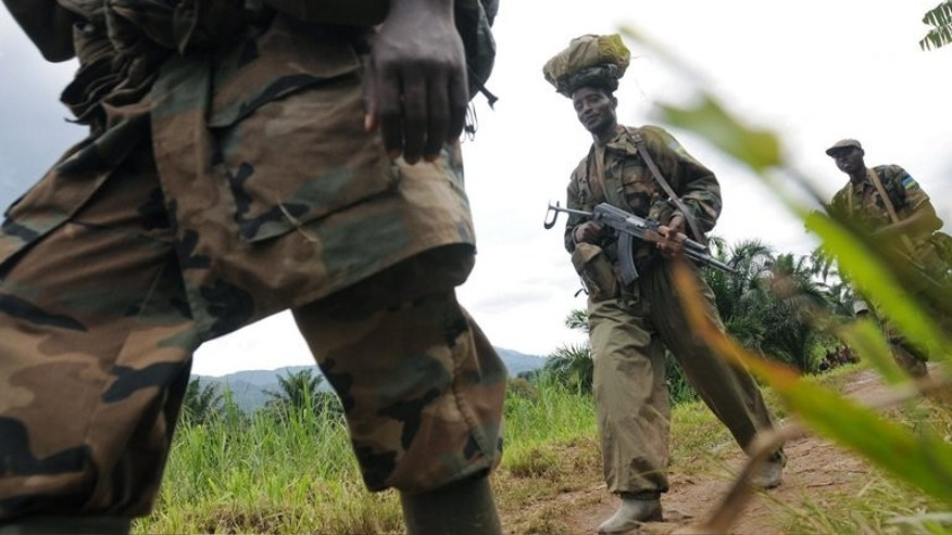 "Rwandan Defence Force soliders on February 05, 2009 in Pinga, 150kms north west of Goma. Rwanda's army has warned neighbouring Democratic Republic of Congo, who it accuses of deliberate bombing over the border, that it will not stand by ""indefinitely"", in a statement late Friday."