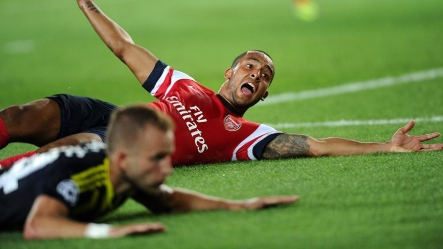 Arsenal's Theo Walcott (R) reacts against Fenerbahce during a UEFA Champions League match in Istanbul on August 21, 2013. The winger said the victory was important following a disappointing defeat to Aston Villa.
