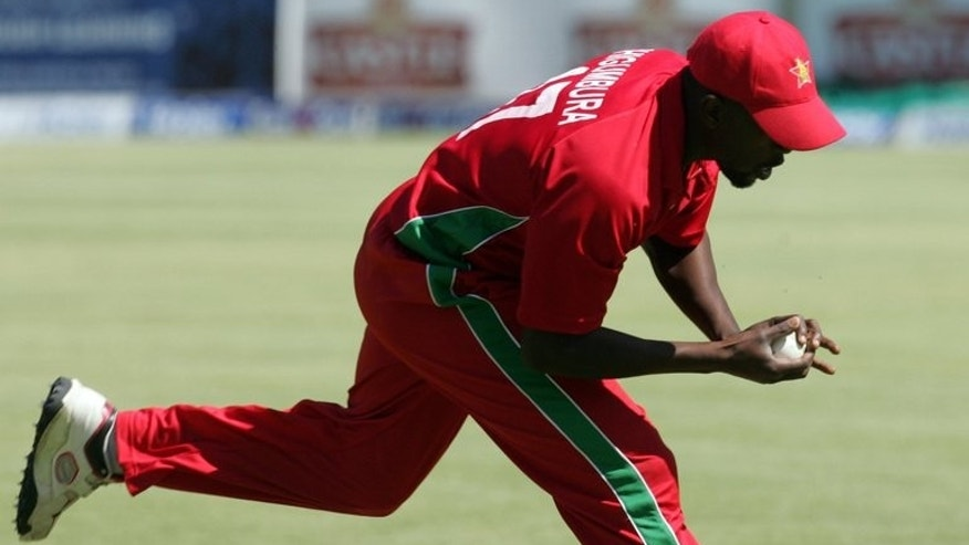 Zimbabwe's fielder Elton Chigumbura takes a catch in the deep during the second and final Twenty20 international between Zimbabwe and Pakistan at the Harare Sports Club on August 24, 2013. The home side looked to earn a share of the series on Saturday.