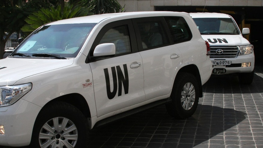 A U.N. team, that is scheduled to investigate an alleged chemical attack that killed hundreds last week in a Damascus suburb, leaves their hotel in a convoy, in Damascus, Syria, Monday, Aug. 26, 2013. An Associated Press photographer saw the U.N. members, wearing body armor, leaving in seven SUVs. It was not clear if the team headed to the suburb where the alleged attack occurred. (AP Photo)