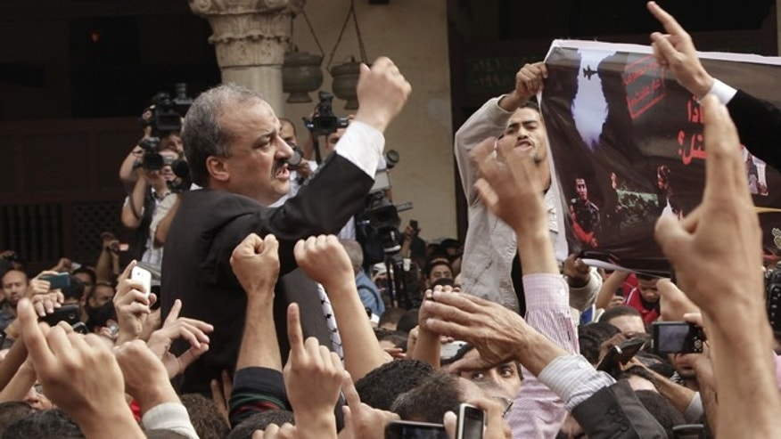 Nov. 16, 2012: In this file photo, protesters led by senior Muslim Brotherhood figure Mohammed el-Beltagy, and former member of the Egyptian Parliament, Essam Soltan, unseen, chant slogans against the Israeli invasion of Gaza, in Al-Azhar mosque after Friday prayers, in Cairo, Egypt.