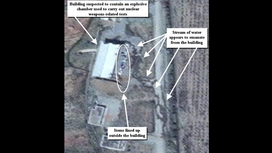 This April 9, 2012 file photo photo provided by the Institute for Science and International Security, ISIS shows suspected cleanup activities at a building alleged to contain a high explosive chamber used for nuclear weapon related tests in the Parchin military complex in Iran. A U.S. institute tracking Iran's nuclear program said Thursday Aug. 22, 2013 that recent satellite images of the Parchin military complex it has analyzed show further major alterations of a military site that the U.N. has long tried to access to follow up suspicions that Tehran may have used it in attempts to develop atomic arms.