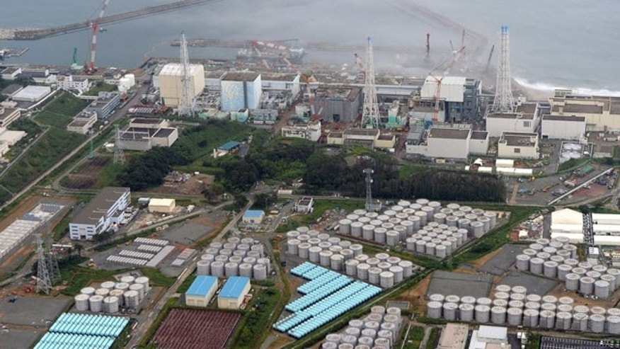 "FILE - This Aug. 20, 2013 aerial file photo shows the Fukushima Dai-ichi nuclear plant at Okuma in Fukushima prefecture, northern Japan. Japan's nuclear regulator has upgraded the rating of a leak of radiation-contaminated water at its tsunami-wrecked nuclear plant to a ""serious incident"" on an international scale. (AP Photo/Kyodo News, File)"