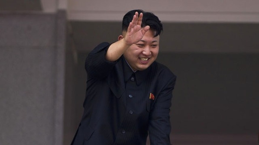 FILE - In this July 27, 2013 file photo, North Korean leader Kim Jong Un leans over a balcony and waves to Korean War veterans cheering below at the end of a mass military parade on Kim Il Sung Square in Pyongyang to mark the 60th anniversary of the Korean War armistice. (AP Photo)
