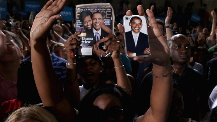 A supporter takes a photograph of U.S. President Barack Obama using an iPhone with an image of the president at a campaign rally at the Kissimmee Civic Center September 8, 2012 in Kissimmee, Florida. (Photo by Chip Somodevilla/Getty Images)