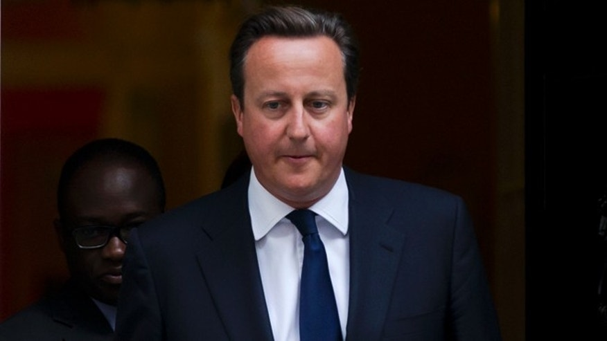April 29, 2013: Britain's Prime Minister David Cameron leaves 10 Downing Street in London, to be driven to the Houses of Parliament for a debate and vote on Syria.