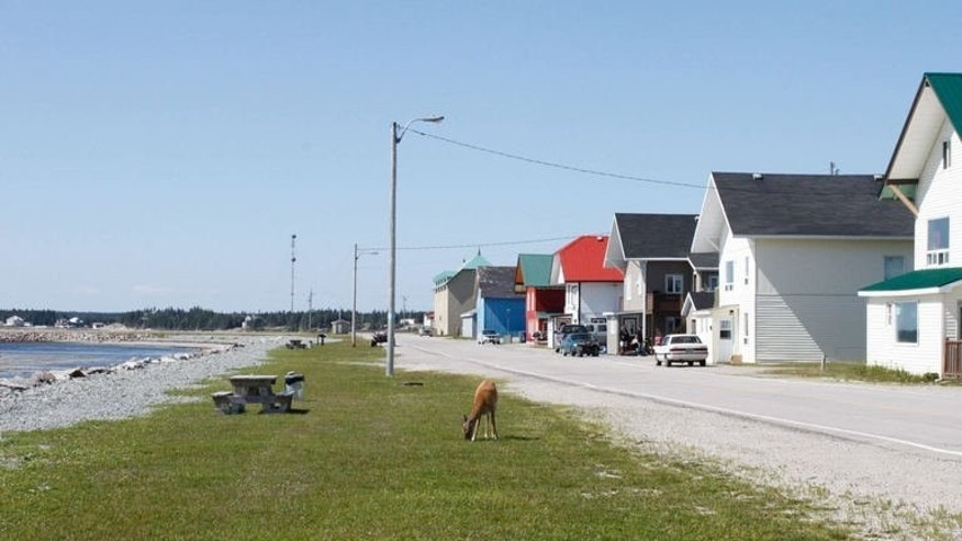 Port-Menier, the only village on Anticosti Island is pictured on August 12, 2013. Quebec's largest energy firm, Petrolia, is eyeing an estimated 40 billion barrels of oil beneath the surface of Anticosti Island, an ecological gem at the mouth of the Saint Lawrence.