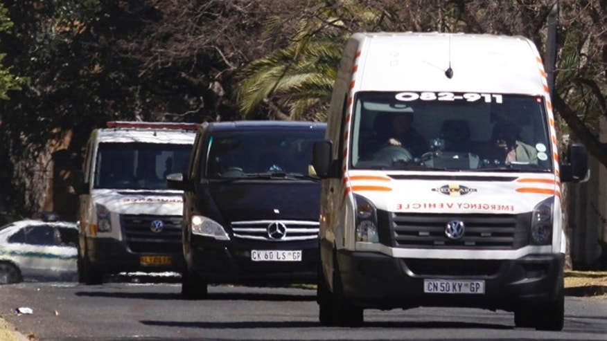 Sept. 1, 2013: An ambulance transporting former South African president Nelson Mandela arrives at the home of the former statesman in Johannesburg, South Africa.