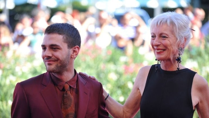 """Canadian director Xavier Dolan and Canadian actress Lise Roy arrive for the screening of """"Tom a la Ferme"""" presented in competition at the 70th Venice Film Festival on September 2, 2013."""