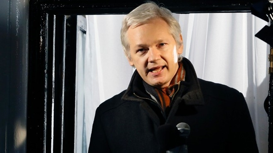 This is a Thursday, Dec. 20, 2012 file photo of Julian Assange, founder of WikiLeaks as he speaks to the media and members of the public from a balcony at the Ecuadorian Embassy in London. Assange has asked Swedish police to investigate what happened to a suitcase he suspects was stolen from him when he traveled from Sweden to Germany in 2010.