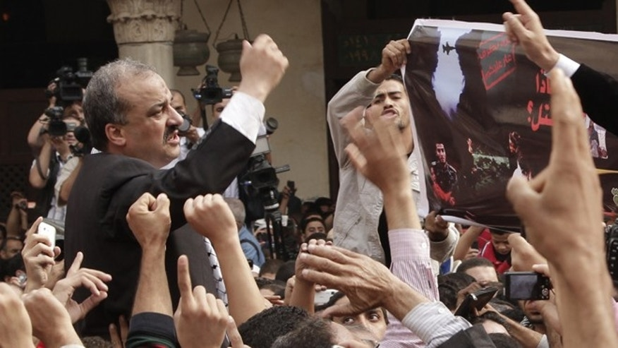Nov. 16, 2012: Protesters led by senior Muslim Brotherhood figure Mohammed el-Beltagy and former member of the Egyptian Parliament, Essam Soltan, unseen, chant slogans against the Israeli invasion of Gaza, in Al-Azhar mosque after Friday prayers in Cairo, Egypt. The fugitive leader of Egypt's Muslim Brotherhood denied media allegations that his group is waging a 'terror' campaign. (AP/Thomas Hartwell, File)