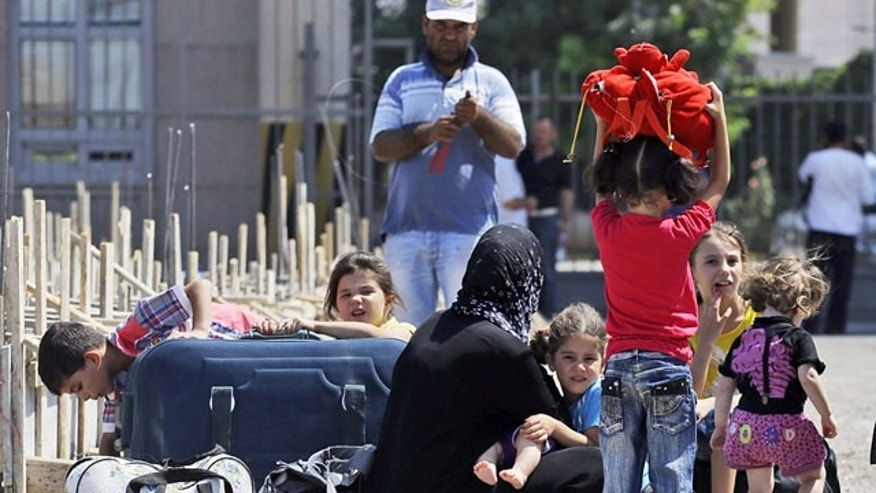 September 2, 2013: Syrian refugees arrive at the Turkish Cilvegozu gate border.
