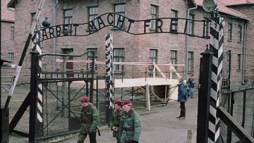 """FILE: This image shows the of the gate at Auschwitz, former Nazi concentration camp, with slogan """"Work Makes You Free."""" (AP)"""