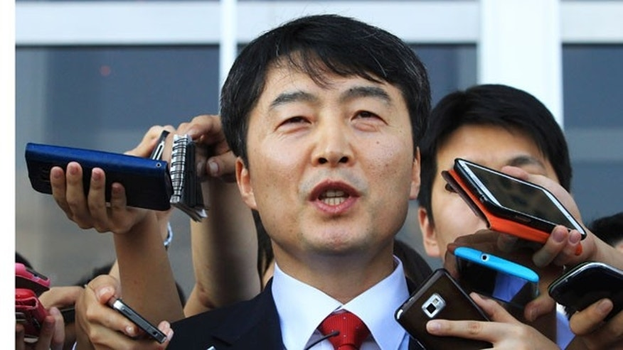 September 4, 2013: Rep. Lee Seok-ki of the leftist Unified Progressive Party speaks before leaving the National Assembly in Seoul, South Korea. South Korea's parliament on Wednesday paved the way for the possible arrest of Lee accused of plotting to topple the government should a war with North Korea break out. (AP Photo)