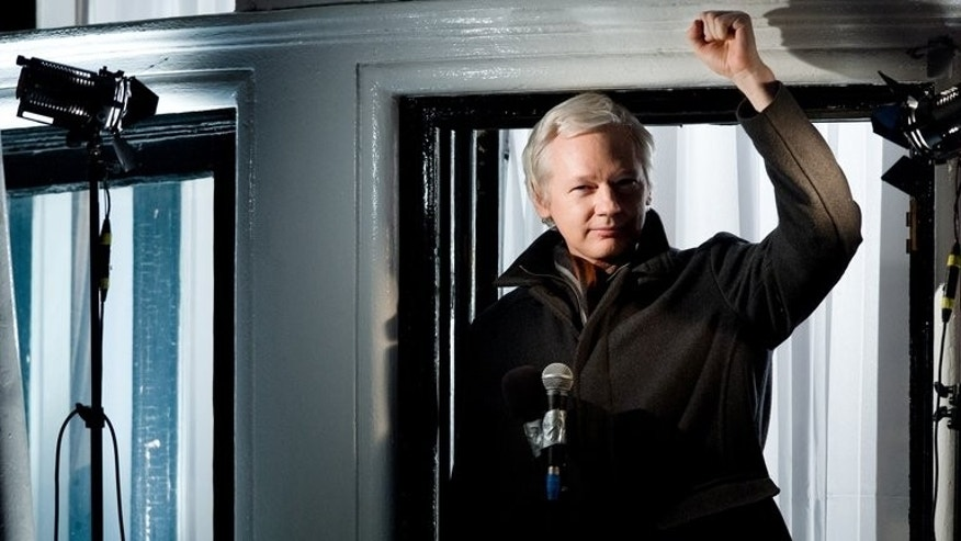 "Wikileaks founder Julian Assange speaks from the window of the Ecuadorian embassy in London on December 20, 2012. North America's largest film festival opens Thursday with a drama about Assange, promising the ""full story"" behind the whistleblower website."