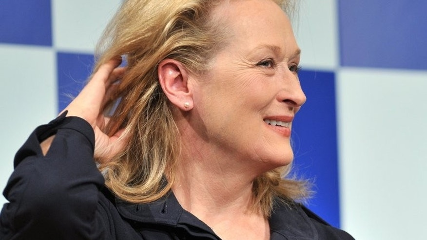 "Meryl Streep poses during a photo session after a press conference to promote ""The Iron Lady"" in Tokyo March 7, 2012. She is set to appear at the Toronto International Film Festival which starts Thursday."
