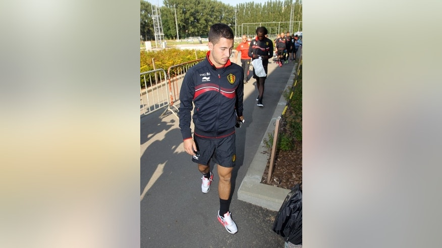 Belgium's Eden Hazard arrives for a training session of the Belgian national team, the Red Devils, in Brussels, on September 4, 2013, ahead of their 2014 FIFA World Cup qualification match against Scotland, taking place on September 6 in Glasgow.