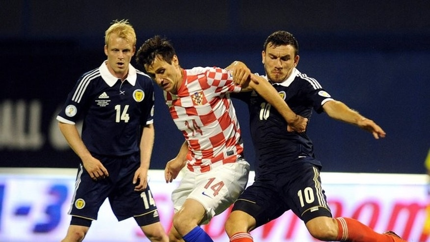 In this file photo, Croatia's Nikola Kalinic (C) fights for the ball with Scotland's Robert Snodgrass (R) and Steven Naismith during their 2014 FIFA World Cup qualification match, at the Maksimir stadium in Zagreb, on June 7, 2013. Snodgrass scored the winner in their shock 1-0 defeat to secure Scotland's first victory in a poor Group A qualifying campaign.