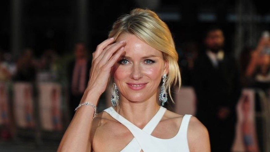"British-Australian actress Naomi Watts poses on the red carpet as she attends the world premiere of ""Diana"" in central London on September 5, 2013."