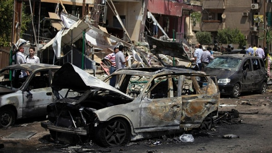 Sept. 5, 2013: Egyptian security personnel investigate the scene of a bomb attack targeting the convoy of Egypt's Interior Minister Mohammed Ibrahim, in Nasr City, Cairo, Egypt.