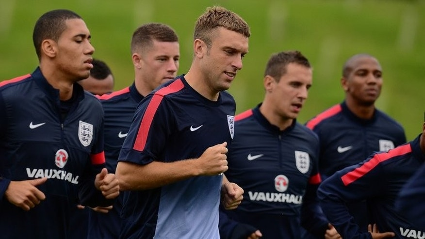 England's Rickie Lambert (C) jogs with his teammates during a training session ahead of their 2014 FIFA World Cup European zone qualifier against Moldova, at St George's Park training complex in Burton-on-Trent, central England, on September 3, 2013.