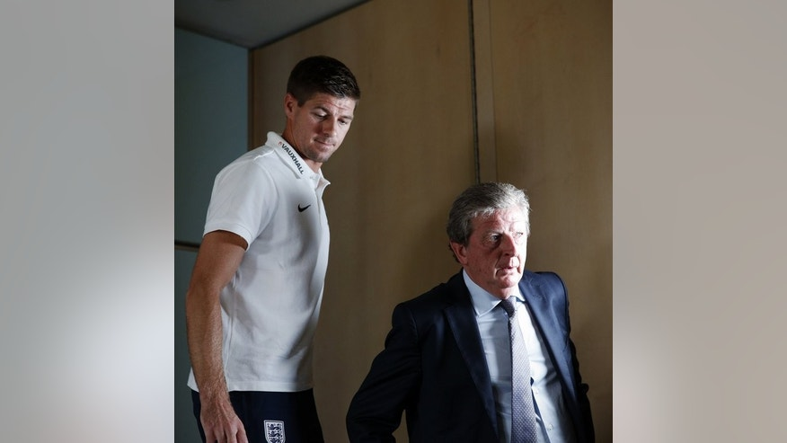 England manager Roy Hodgson (R) and team captain Steven Gerrard leave a press conference in north London on September 5, 2013. Hodgson has made it clear he didn't want to be drawn into a lengthy debate about Greg Dyke's views when he was quizzed at the press conference.