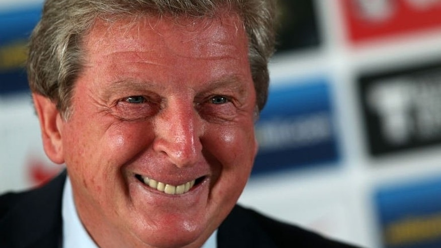 England's manager Roy Hodgson smiles during a press conference at The Grove, the team hotel, in Watford, north of London, on September 5, 2013 ahead of their World Cup 2014 qualifying football match against Moldova at Wembley on September 6.